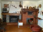 4. Woonkamer met opern haard en oven